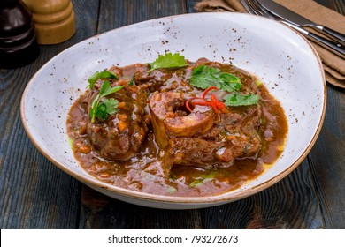 Osso Bucco on wooden background