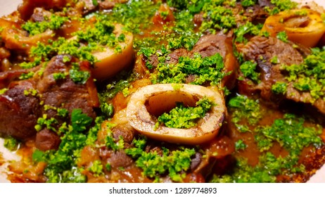 Ossobuco or osso buco is a specialty of Lombard cuisine (Italy) of cross-cut veal shanks braised with vegetables, white wine and broth