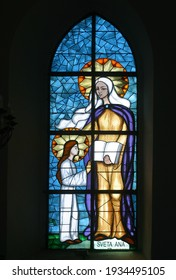 OSTARIJE, CROATIA - JULY 14, 2013: Saint Anne, Education of the Virgin Mary, stained glass window at Our Lady of Miracles Parish Church in Ostarije, Croatia