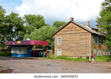 OSTASHKOV / RUSSIA – JULY 15, 2012: Оld wooden house and bus stop in Russia.
