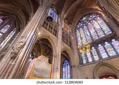 Ostend, Belgium - 11 April 2017, interior of a Gothic Cathedral, light passes through stained glass Windows