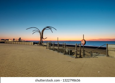 Ostend, Belgium - 24 February, 2019: The iron sculpture 'Dansende Golven' (Dancing Waves) near the beach of Oostende at sunset
