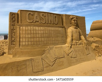 Ostend Belgium, 3 August 2019: beautiful 3D carved sand sculpture art on the beach with the theme of Casino