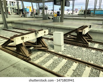 Ostend Belgium, 3 August 2019: wooden bump blocks fenders on the end of a railroad track in a railway train station