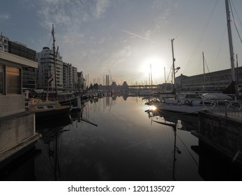 "Ostend, Belgium - 7 August 2018: Image of the marina ""Mercator"" in Ostend with the railway station in the background."