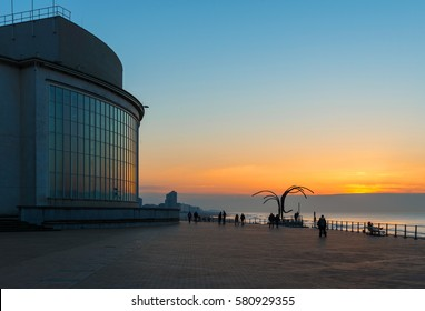 OSTEND, BELGIUM - FEBRUARY 14 2017: An evening walk along the embarkment of Ostend in front of the North Sea.