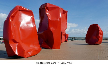 OSTEND, BELGIUM – SEPTEMBER 17, 2018:Artwork the 'Rock Strangers' by Arne Quinze on the Zeeheldenplein in Ostend. It consists of eleven gigantic large metallic orange-red blocks in the form of stones.