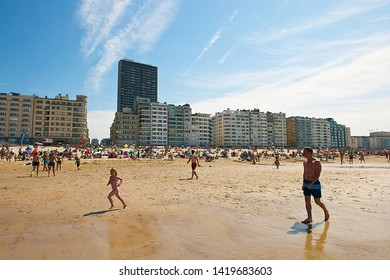 Ostend, Belgium-07 24 2014:People enjoying the beach in Ostend, a coastal city, the largest on the Belgian coast, located in the province of West Flanders.