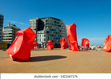 Ostend, Belgium-07 24 2014:The Conceptual work of art named Rock Strangers by Belgian conceptual artist Arne Quinze on the promenade pier at seaside resort Ostend in Belgium.