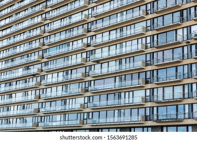 Ostend, West Flanders / Belgium: 10 26 2019: Abstract view of the patterns of windows and balconies of a typical second residence apartement block