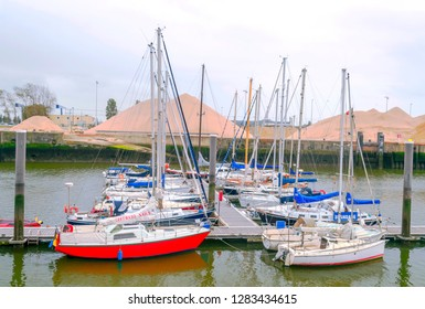 OSTENDE, FLANDES, BELGIUM-SEPTEMBER 2014. Dock with boats moored in the Atlantic ocean on a cloudy day.