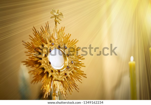 Ostensory for worship at a Catholic church ceremony - Adoration to the Blessed Sacrament - Catholic Church - Eucharistic Holy Hour - Corpus Christi