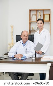 Osteopath and his assistant in office
