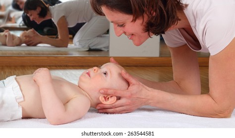 A Osteopathy with baby with blockade on cervical vertebrae