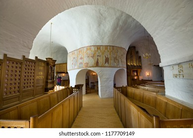 OSTERLARS, DENMARK - AUGUST 23, 2018: Interior of defensive round church. It is one of four round churches on the Bornholm island. Built about 1150, regarded the oldest round church.