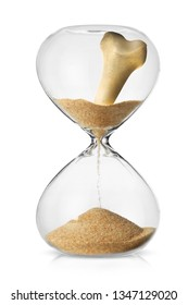Osteroposis concept with human bones turning in to sand flowing in a sand glass watch time is passing
