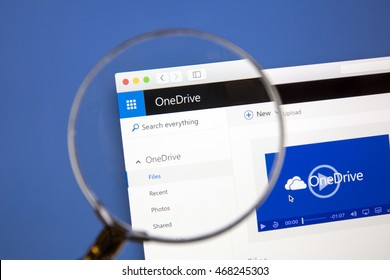 Ostersund, Sweden - Aug 14, 2016: Microsoft OneDrive website under a magnifying glass. Microsoft OneDrive is a file hosting service.