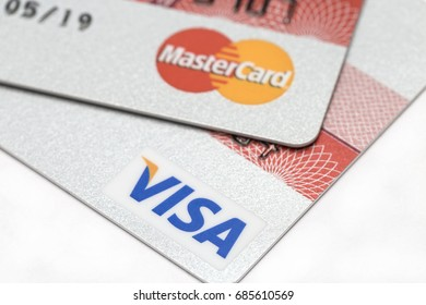 Ostersund, Sweden- July 28, 2017: Visa and Mastercard logos on credit cards. Visa and Mastercard are the two biggest credit card companies