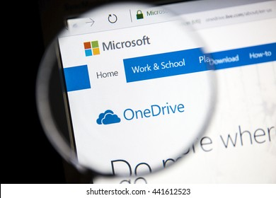 Ostersund, Sweden - June 23, 2016: Microsoft OneDrive website under a magnifying glass OneDrive is a file hosting service that allows users to sync files and later access them.