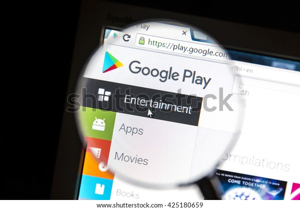Ostersund, Sweden - May 23, 2016: Google Play's website under a magnifying glass Google Play is a digital distribution platform operated by Google.