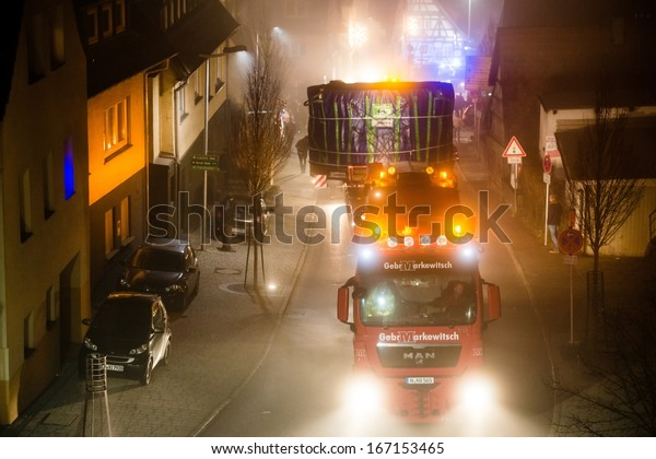 OSTFILDERN, GERMANY - DECEMBER 12, 2013: Heavy tunnel digging machinery loaded on a flatbed trailer is carried to the construction site of Stuttgart 21 on December 12, 2013 in Ostfildern-Scharnhausen