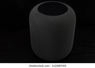 Ostfildern, Germany - June 26, 2018: Using an Apple HomePod speaker - the smart speaker is reacting to voice input, playing music, providing information or steering smart home devices.