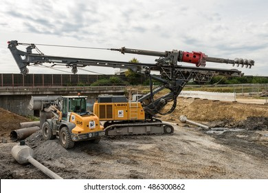Ostfildern, Germany - September 3, 2016: A large rotary drill and excavator at a construction site of the Stuttgart21 railroad project in Ostfildern: This site is part of the Stuttgart21 project where