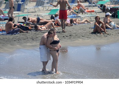 ostia, italy - August 2nd, 2017: people enjoing the beach during hot summer in rome