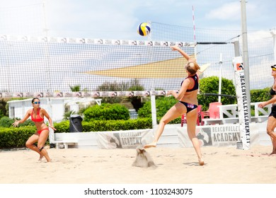 OSTIA, ITALY. May 27, 2015: Woman hit the ball during a beachvolley match between friends on the sand at the sea in Ostia, a town near Rome in Italy. Summer sports and recreation activity.