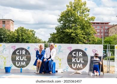 Ostrava, Czech Republic - 10.8.2021: Gymnastic acrobatic duo performing in show. Cirkulum festival