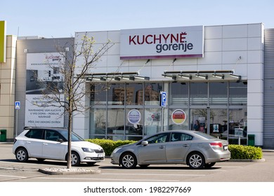 OSTRAVA, CZECH REPUBLIC - APRIL 28, 2021: The entrance to the Kuchyne Gorenje store in Futurum shopping mall in Ostrava with parked cars in front of it. The store sells kitchens