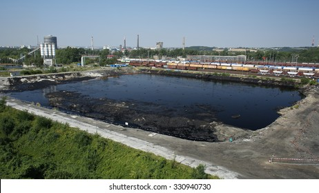OSTRAVA, CZECH REPUBLIC - AUGUST 3, 2015: The former dump toxic waste in Ostrava, oil lagoon, oil pollution, Ostramo, effects nature from soil contaminated with chemicals and oil, Europe, EU