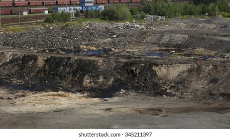 OSTRAVA, CZECH REPUBLIC - AUGUST 3, 2015: The former dump toxic waste in Ostrava, oil lagoon, Ostramo, effects nature from soil contaminated with chemicals and oil, Moravia-Silesia Region, Europe, EU