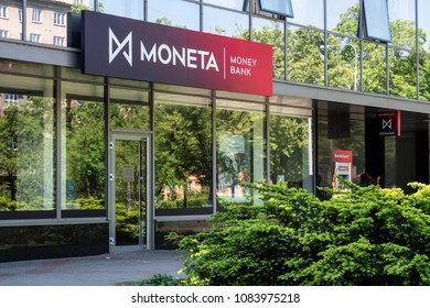 OSTRAVA, CZECH REPUBLIC - MAY 5, 2018: Entrance to the building of Moneta Money Bank with reflection in the windows and ATM. The image was taken in Ostrava-Poruba, Czech Republic on May 5, 2018.