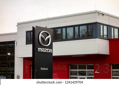 OSTRAVA, CZECH REPUBLIC - NOVEMBER 24, 2018: The Mazda logo on a building of Kodecar company, the car dealer of Mazda vehicles and other brands located in Ostrava-Poruba.