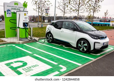 OSTRAVA, CZECH REPUBLIC - NOVEMBER 27, 2018: BMW i3 electric car is charged on a green parking space next to the Lidl shopping mall in Ostrava providing this free service to its customers.