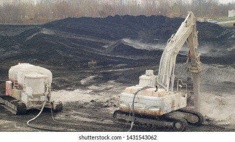 OSTRAVA, CZECH REPUBLIC, NOVEMBER 28, 2018: Liquidation of remediation of landfills waste of oil and toxic substances sludge, burnt lime is applied to oil pollution by means of fine cutter excavator