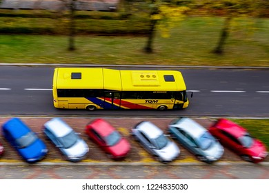 OSTRAVA, CZECH REPUBLIC - OCTOBER 30, 2018: Fast SOR CN12 bus of the TQM company based in Opava city driving through Ostrava-Poruba in Czech Republic. The image has a strong motion blur effect.