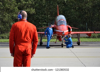 OSTRAVA, CZECH REPUBLIC - SEPTEMBER 22: Engineers of the RAF aerobatic team Red Arrows prepare jet for takeoff on September 22, 2012 in Ostrava, Czech republic. 208 000 people visited NATO Days.