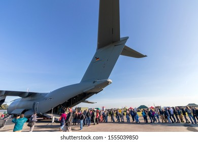 OSTRAVA, CZECH REPUBLIC - SEPTEMBER 22, 2019: NATO Days. C-5M Super Galaxy transport aircraft on display for the first time. Large crowd of visitors wait in line to view cargo bay,