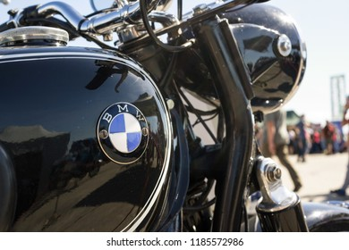 Ostrava, Czechia - September 16, 2018: Detail of historic motorbike - fuel tank with BMW brand logo. manufacturer, producer and maker of bikes and motorcycles (very low depth of field, sunflare)