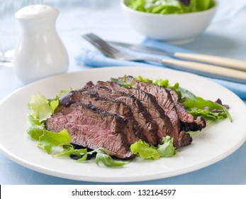 Ostrich steak with fresh salad, selective focus