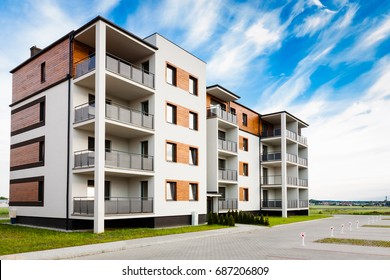 Ostrow, Poland - June 13,2016: New multi-family block with balconies and bright facade decorated with wood paneling.