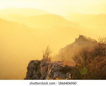 Ostry kamen castle ruin in Little Carpathians mountains at sunset,Slovakia