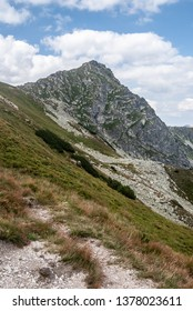 Ostry Rohace mountain peak from hiking trail bellow Ziarske sedlo on Rohace mountain group in Zapadne Tatry mountains in Slovakia during beautiful summer day