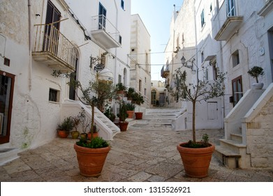 OSTUNI, APULIA, ITALY - MARCH 28th, 2018: Typical street of Ostuni, La Citta Bianca. Ostuni. Apulia, Italy