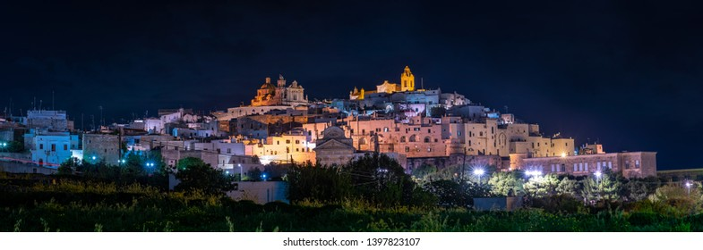 Ostuni by night, the white city in Apulia, panoramic wide view. southern Italy