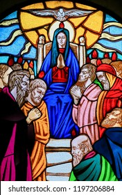 Ostuni, Italy - March 14, 2015: Stained glass window depicting Mother Mary and the Disciples of Christ at Pentecost in the Church of Ostuni, Apulia, Italy.