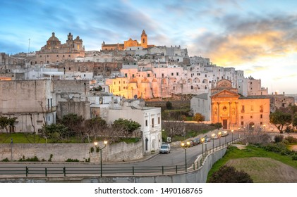 Ostuni, Puglia, Brindisi, Italy - February 15, 2019: Panorama of The picturesque old town and Roman Catholic cathedral, Madonna della Grata church and Confraternity of Carmine. The white city apulia