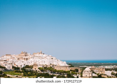 Ostuni white town and Madonna della Grata church with clean blue sky, Brindisi, Apulia, southern Italy, Europe. Panorama view